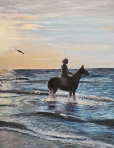 Girl on horse at beach